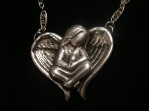 Hand carved, cast and finished Sterling Silver necklace in memory of Erin.